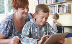 teacher_student_using_ipad_computer_tablet_iStock_000046062474_XXXSMALLER.jpg