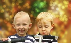 Happy boy, sad boy on scooter – Handling kids' present expectations at Christmas